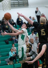 Elijah McCloskey scores against rival Paint Valley last season at Huntington High School.