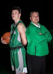 Elijah McCloskey with Huntington High School basketball coach Eric Snyder.