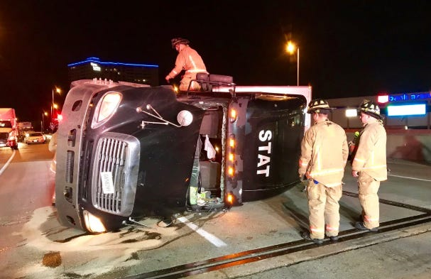A semi hauling bricks overturned on westbound Fort Washington Way at Lytle Tunnel, closing southbound I-71 on Tuesday morning.