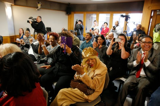 JoAnne Summerow, center, mother of Stephanie Summerow Dumas, along with other family and friends applaud as  Dumas is sworn in as a new Hamilton County Commissioner on Tuesday, January 8, 2019. Dumas is the first African-American Hamilton County Commissioner and the first African-American female in the State of Ohio to become a county commissioner.