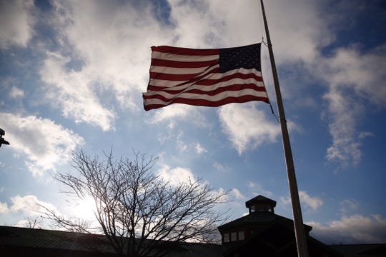 The U.S. flag flies at half mast at the Colerain Township Police Department Tuesday, January 8, 2019. Colerain Township Police Officer Dale Woods was hit by a pickup truck while on-duty at the scene of a crash Friday night, died Monday night. Cara Owsley/The Enquirer