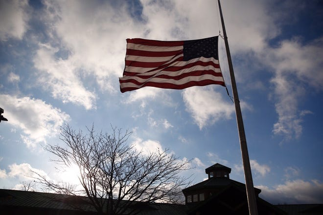A flag flies at half-mast to honor Colerain police officer Dale Woods, who died Monday night.