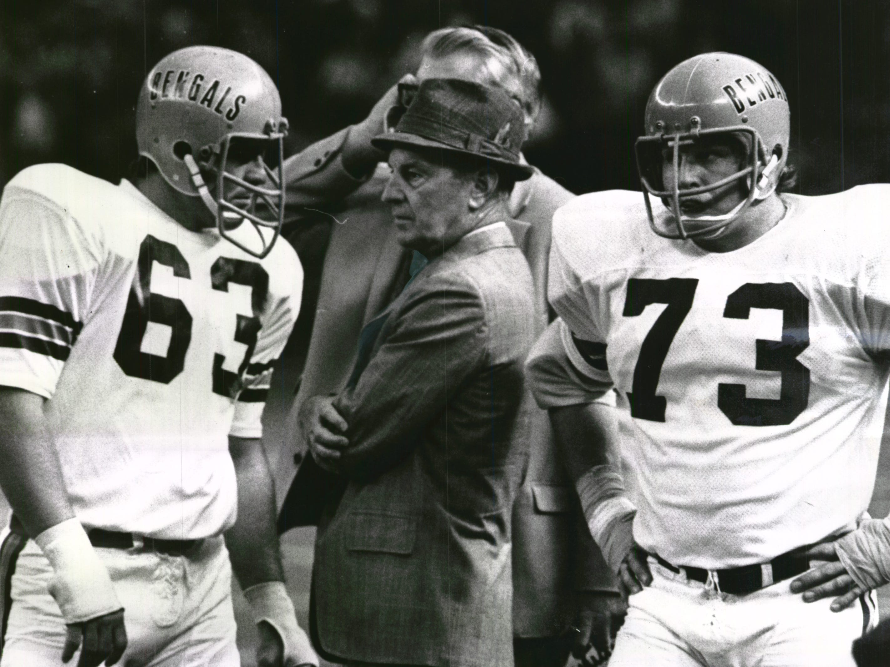NOVEMBER 2, 1971: Messengers Await The Message...Bengal play-couriers Guy Dennis (63) and Pat Matson (73) wait while Paul Brown confers with aide Bill Johnson (behind Brown) to choose a play in Sunday's loss to Houston. The Enquirer/Fred Straub