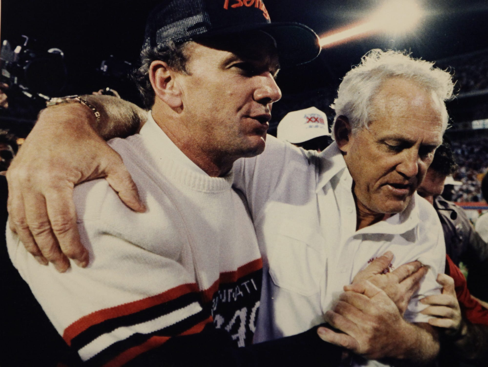 "Bengals head coach Sam Wyche, left, and San Francisco head coach Bill Walsh said ""I love you"" to each other after the 49ers beat Cincinnati in the final seconds of Super Bowl XXIII in Miami, January 22, 1989. The Enquirer/Michael E. Keating"