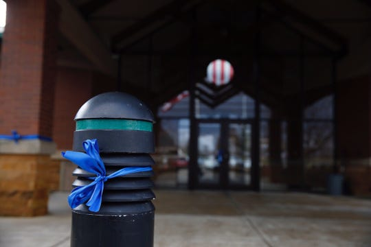 A blue ribbon honors Colerain police officer Dale Woods, who died Monday night.