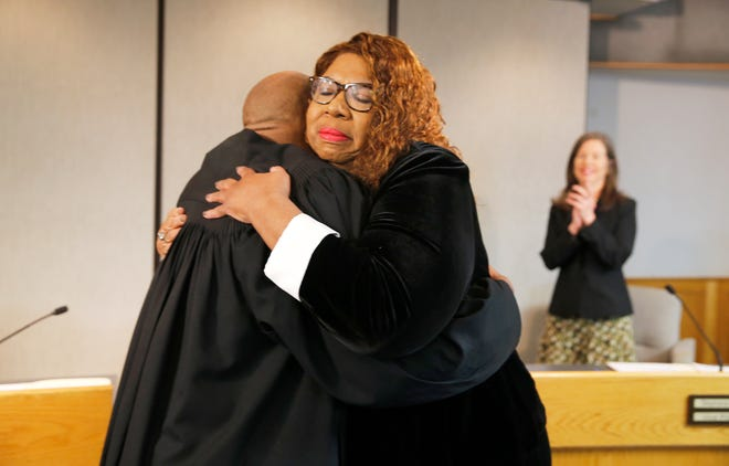Stephanie Summerow Dumas hugs Judge Fanon Rucker after she is sworn in as a new Hamilton County Commissioner on Tuesday, January 8, 2019. Dumas is the first African-American Hamilton County Commissioner and the first African-American female in the State of Ohio to become a county commissioner.