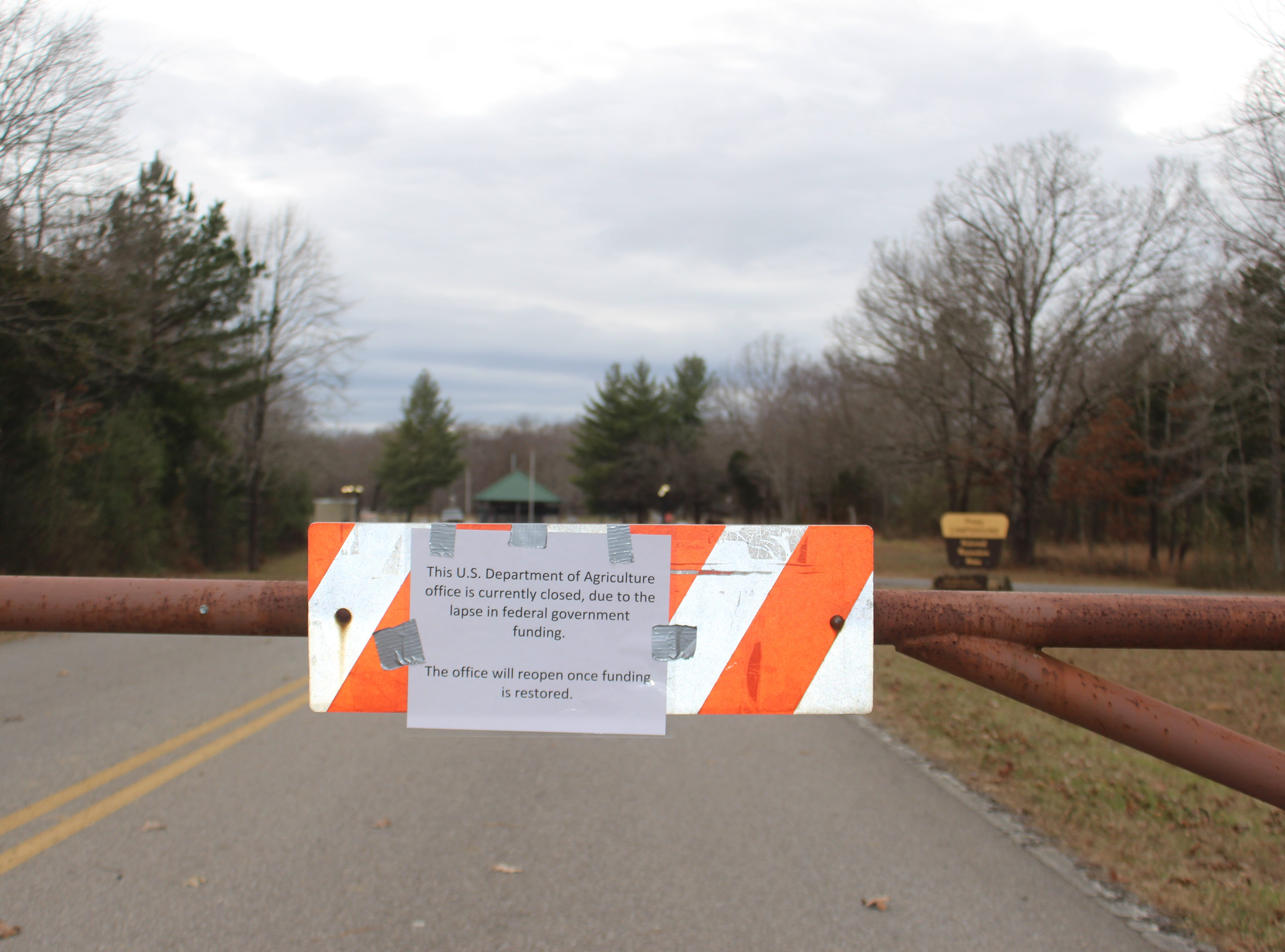 A sign informs visitors that facilities at Land Between the Lakes National Recreation Area are closed due to a lapse in federal funding as the government shutdown continues.