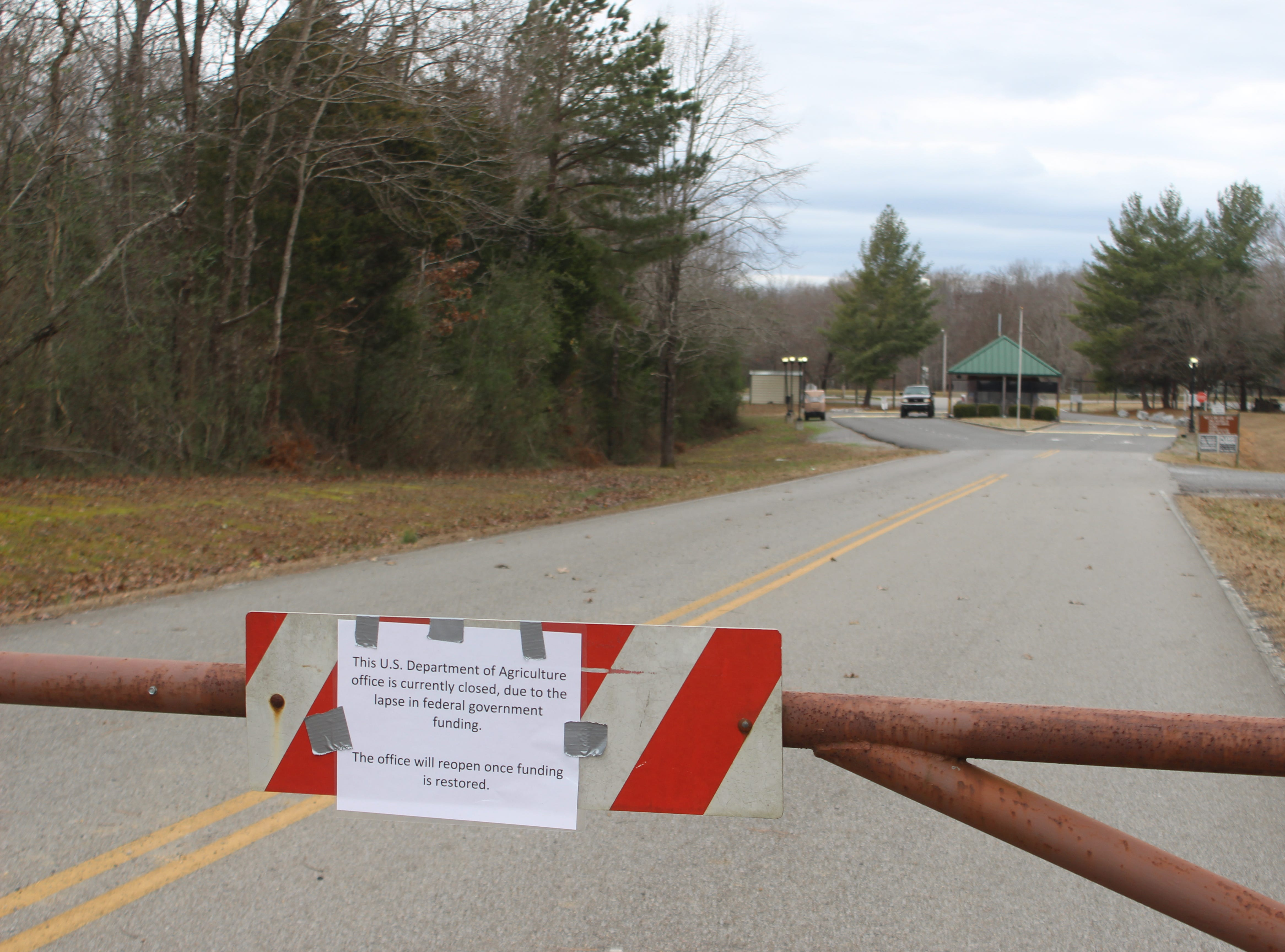 A locked gate with a sign announcing the closure greets visitors at Piney campground at Land of the Lakes National Recreation Area as the government shutdown rolls into its third week.
