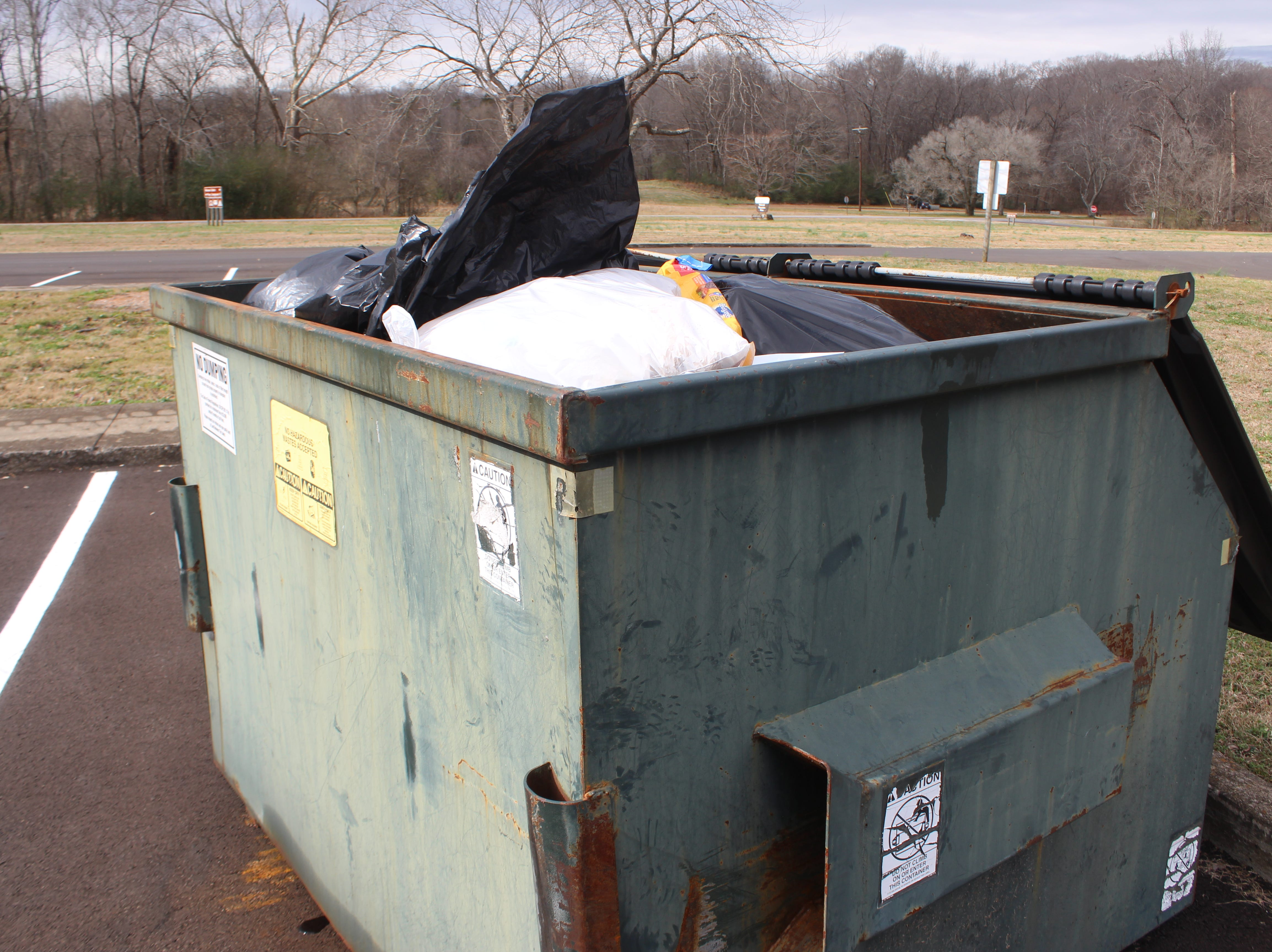 A dumpster at the South Welcome Station at Land Between the Lakes National Recreation Area is filled to the top as the government shutdown rolls into its third week.