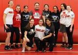 Bishop Ahr High School's wrestling program features nine girls