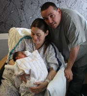 (Left to Right): Sonia and Chris Huhn with their daughter Riley, the first baby born in Hunterdon County in 2019.