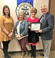 Auditor Clerk Michelle Brown, Deputy Auditor Chris Winegar, City Auditor Sherry Kirkpatrick and Mayor Steve Mercer with a framed certificate recently received from the Ohio Auditor's Office honoring the city for a clean 2017 audit report.