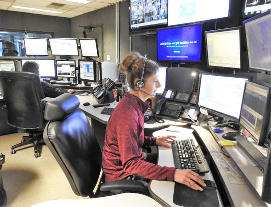Dispatcher Kim Dobson works on equipment and software new to the Coshocton County Sheriff's Office. The Zuercher systems puts dispatch, road deputies and those in the jail all on one system that is faster and more efficient than the antiquated system the office was using.