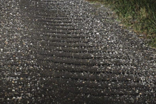 Muscatine County residents say slag, a byproduct from steel production that's used on local gravel roads, easily wash-boards, creating bumps that can send a car skidding.