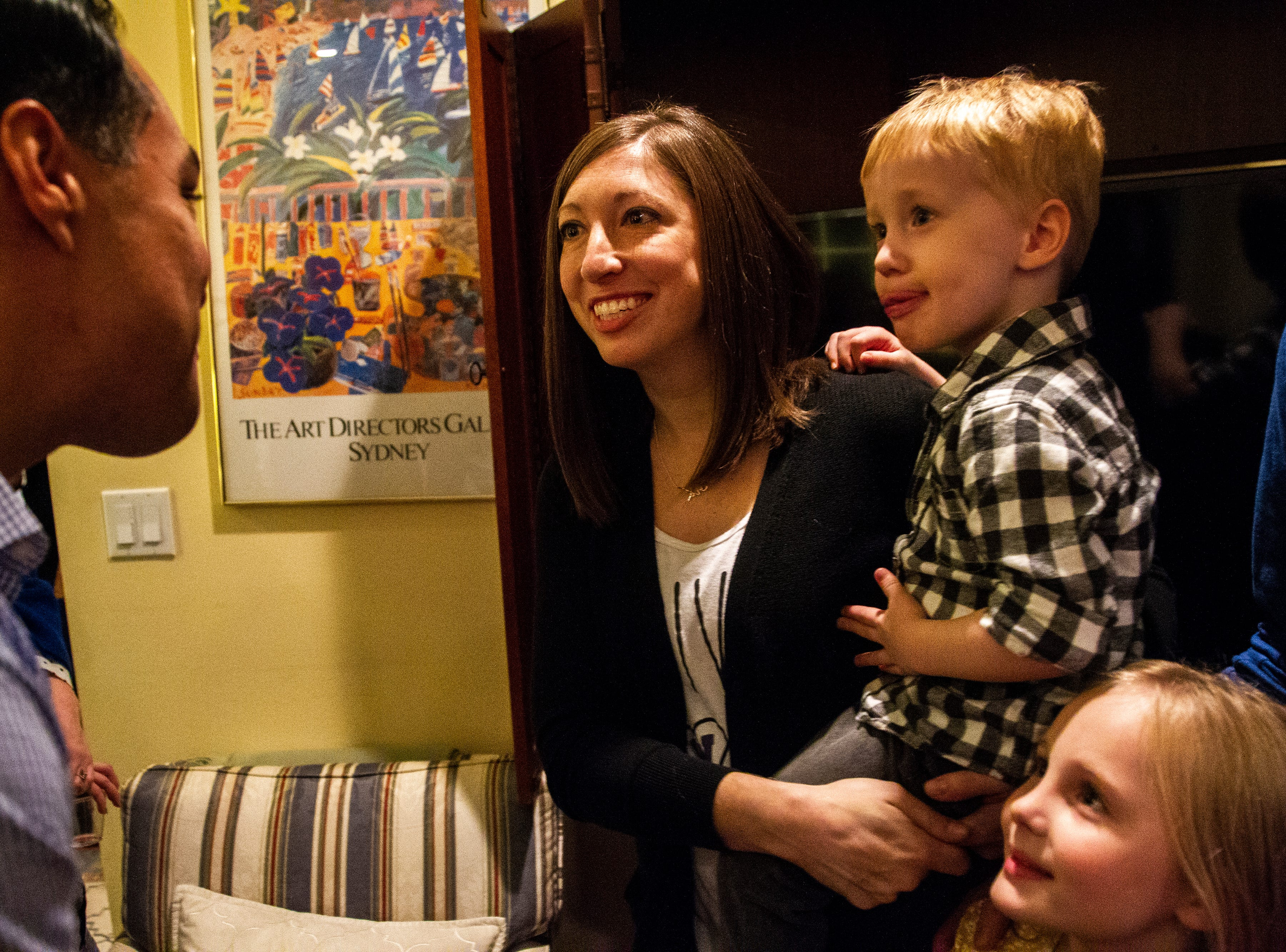 "Julián Castro greets Melissa Eadon along with her children, Maddox, 3, and Aubrey, 6, at the Johnson County ""Potluck Insurgency"" on Monday, Jan. 7, 2019, at a home in North Liberty, Iowa."