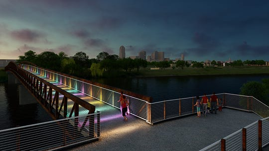 Hubbell Realty Co. has started construction on a pedestrian bridge over the Raccoon River that will connect Gray's Lake to downtown Des Moines.