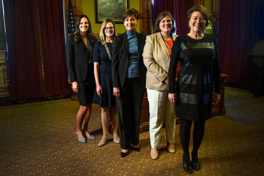Catherine Huggins, Chief Advisor to the Governor, Sara Craig Gongol, Chief of Staff, Kim Reynolds, Governor, Kayla Lyon, Legislative Liaison and Paige Thorson, Deputy Chief of Staff and Policy Advisor on healthcare related issues, poses together for a photo in Reynolds' office on Tuesday, Jan. 8, 2019, at the Iowa State Capitol.