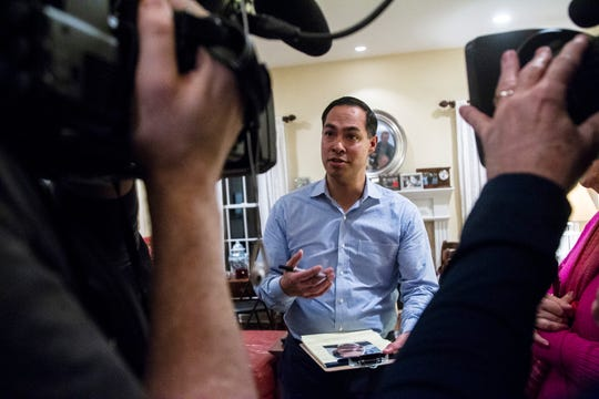 "Julián Castro speaks with reporters at the Johnson County ""Potluck Insurgency"" on Monday, Jan. 7, 2019, at a home in North Liberty, Iowa."