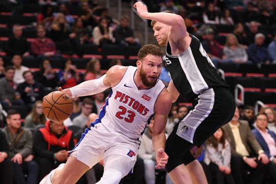 Detroit Pistons forward Blake Griffin (23) drives to the basket against San Antonio Spurs forward Davis Bertans (42) during the first quarter at Little Caesars Arena on Monday, Jan. 7, 2019, in Detroit.