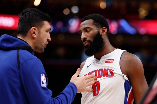 Detroit Pistons center Zaza Pachulia, left, talks with center Andre Drummond during the first half of an NBA basketball game against the San Antonio Spurs, Monday, Jan. 7, 2019, in Detroit.