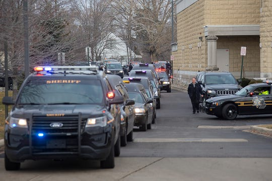 Five hearses are seen after services for Issam Abbas, 42, Rima Abbas, 38, Ali Abbas, 14, Isabelle Abbas, 13, and Giselle Abbas, 7,  at the Islamic Center of America in Dearborn Tuesday Jan. 8, 2019. The Abbas family was killed in a car crash on Sunday Jan. 6, 2019 in Kentucky on their way home from Florida.