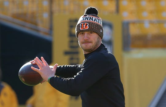 Cincinnati Bengals quarterback Connor Cook warms up before playing the Pittsburgh Steelers at Heinz Field, Dec. 30, 2018.