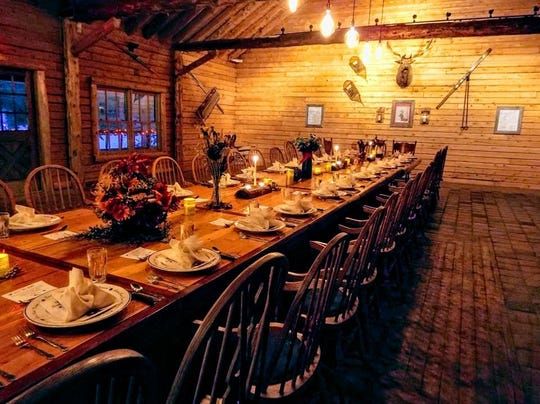 The Wilderness Sleigh Ride dinner is served at a cabin in the woods.