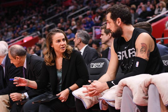 San Antonio Spurs assistant coach Becky Hammon (left)  talks to guard Marco Belinelli (18) during a game against the Detroit Pistons at Little Caesars Arena on Monday, Jan. 7, 2019, in Detroit.