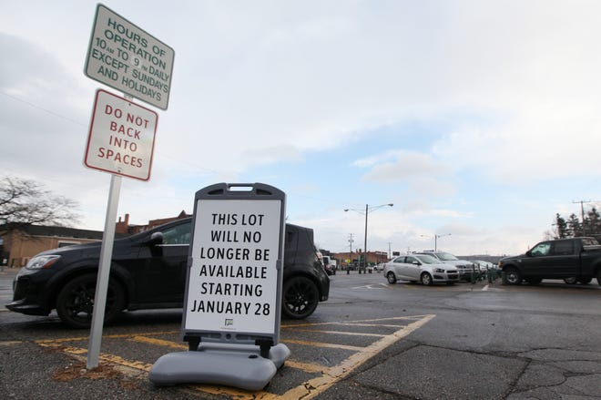 The parking lot at Allen Road and West Troy Street in Ferndale, pictured Jan. 8, has a sign indicating it will be closed starting Jan. 28. There are plans to turn the lot into a mixed-use parking structure.