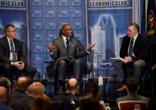 Kevin Johnson, center, President & CEO, Detroit Economic Growth Corporation, answers a question from moderator Daniel Howes, right, during a discussion about Michigan economy while Jeff Mason, left, CEO Michigan Economic Development Corporation listens.