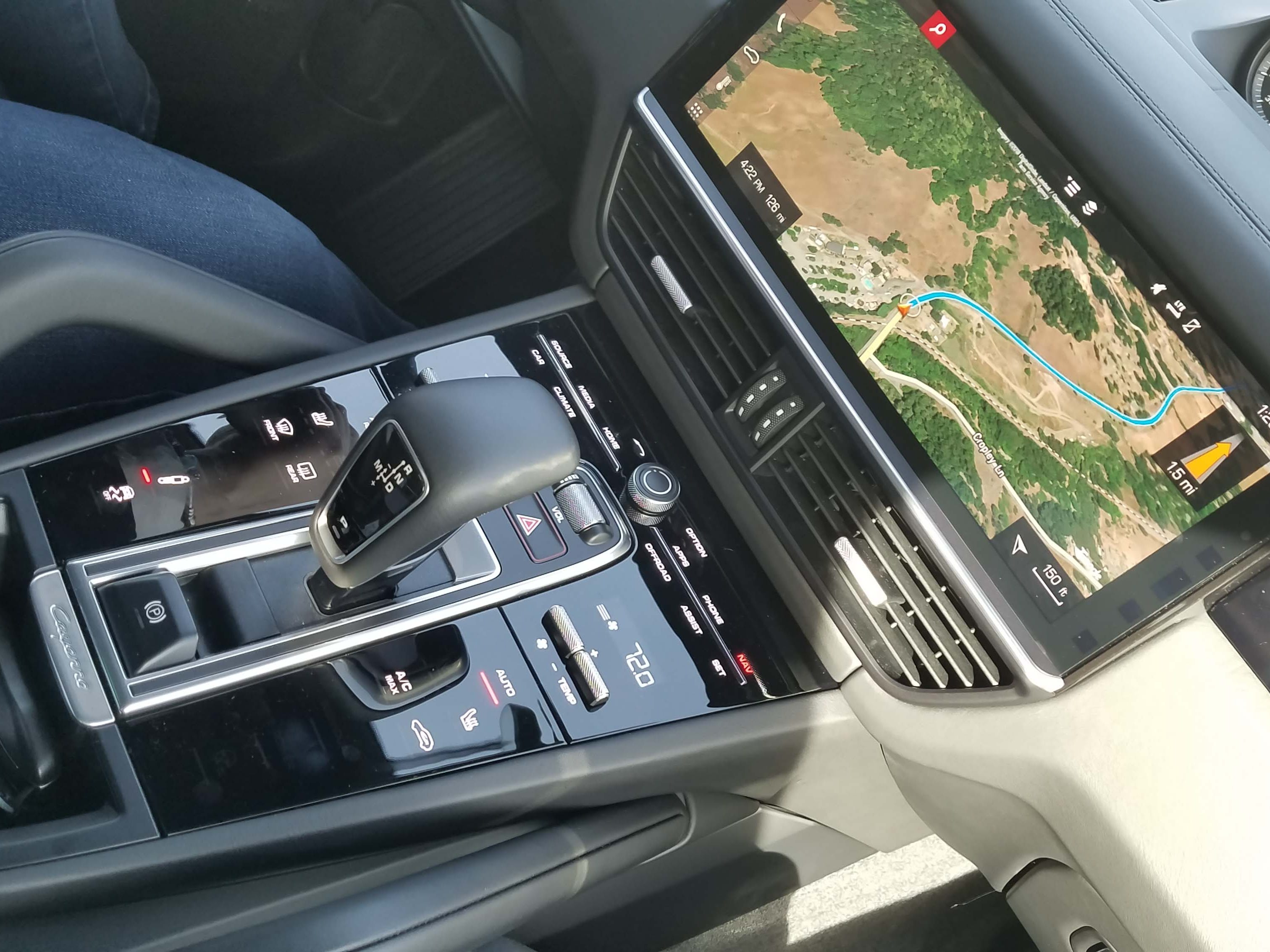 The console of the 2019 Cayenne is much improved over the Gen 2 model — but ergonomics suffer, with many features located out of view behind the monostable shifter.
