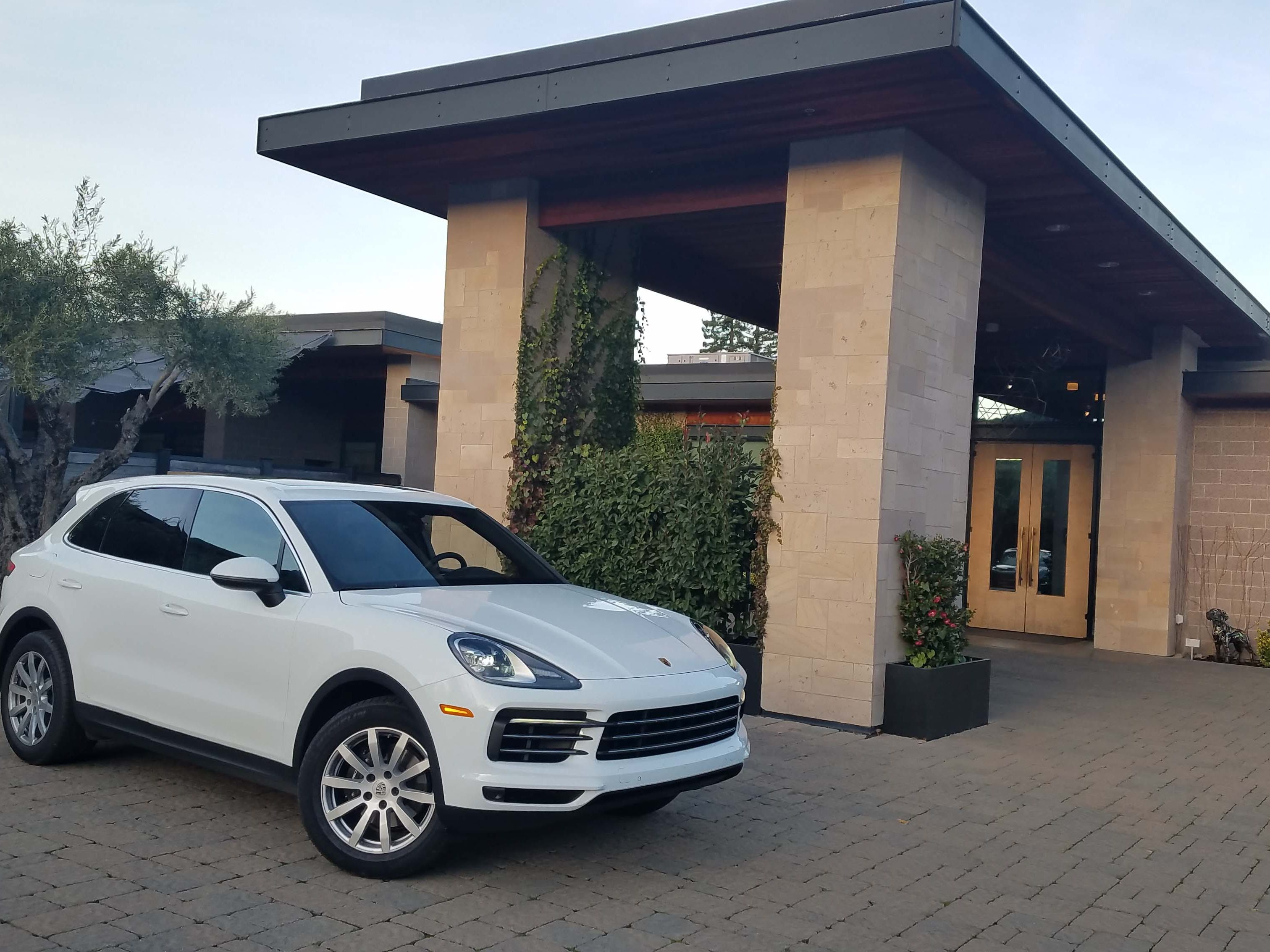 The first sports car maker to debut a performance SUV, Porsche's Cayenne looks sharp rolling up to a ritzy hotel — and seats the family unlike the smaller, 2+2 Porsche 911.