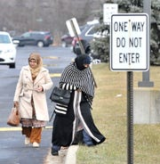 Mourners leave the funeral service for the Abbas family on Tuesday.
