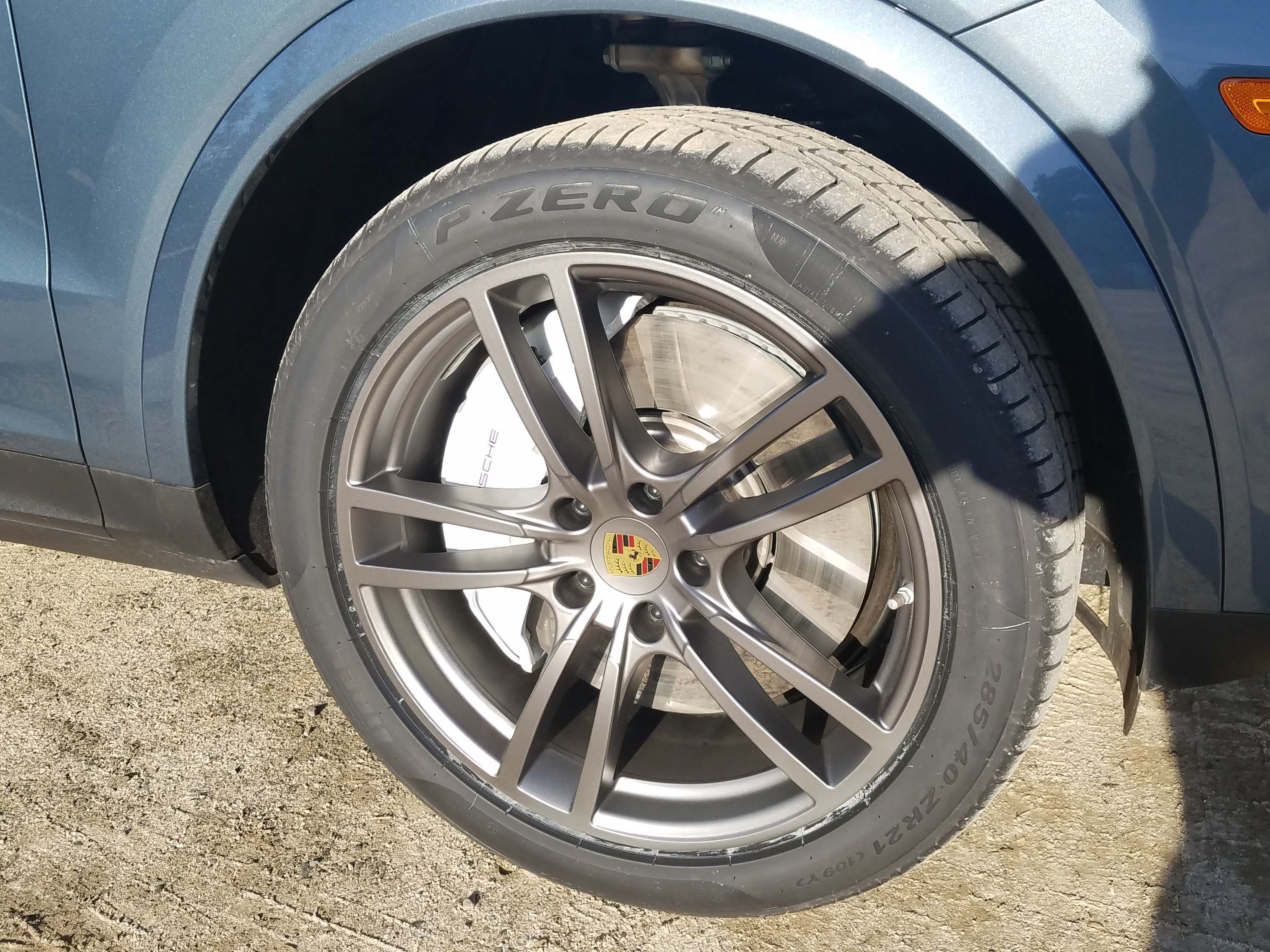 Porsche's surface-coated brakes are a special option to help stop the big ute. The brake package includes huge, 10-pot calipers.