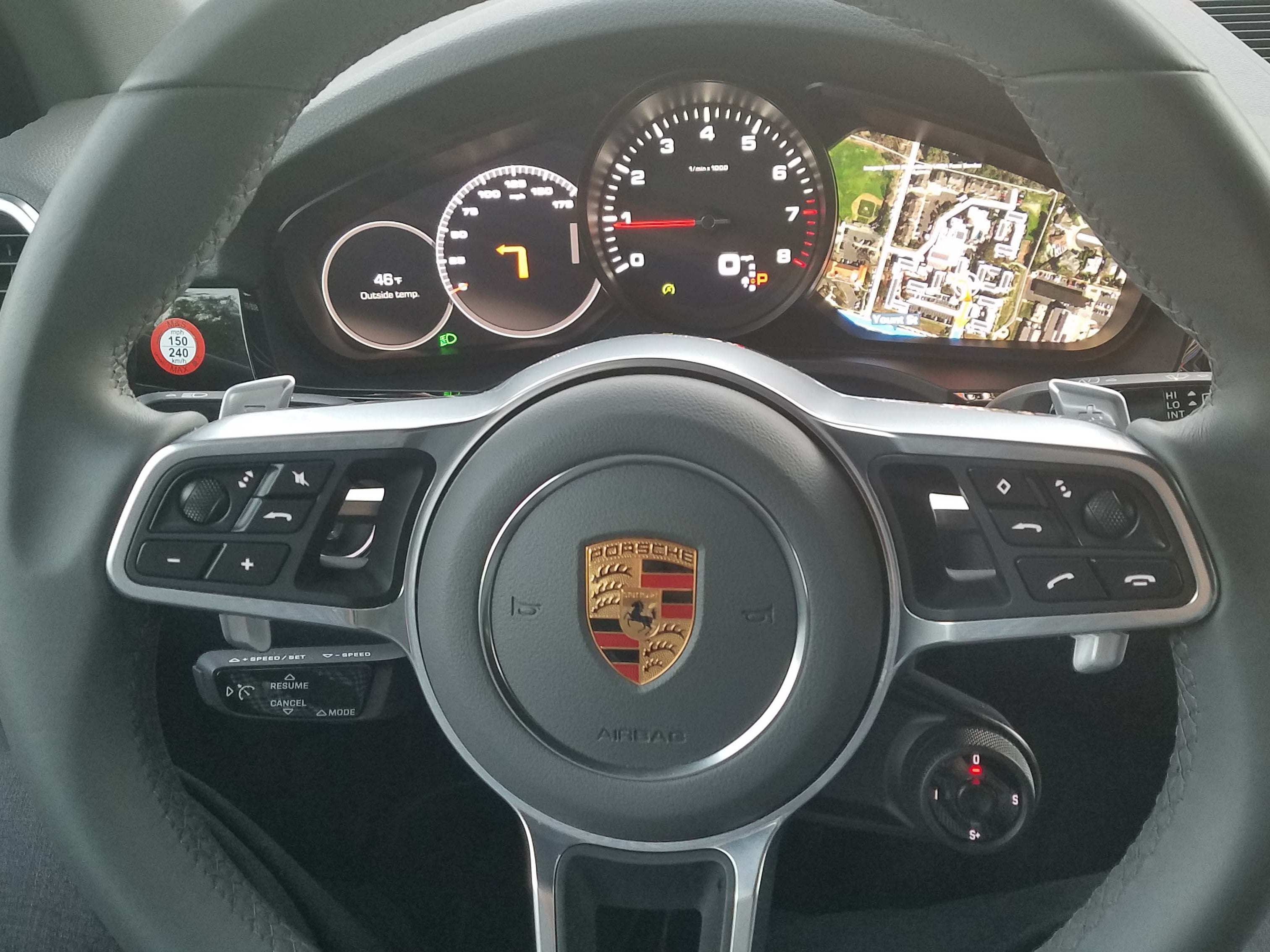 While Porsche keeps its sports car steering wheels spare — the 2019 Cayenne is loaded with gizmos including the Sport Response button hanging off the center hub, cruise control stalk and buttons for volume/voice commands.