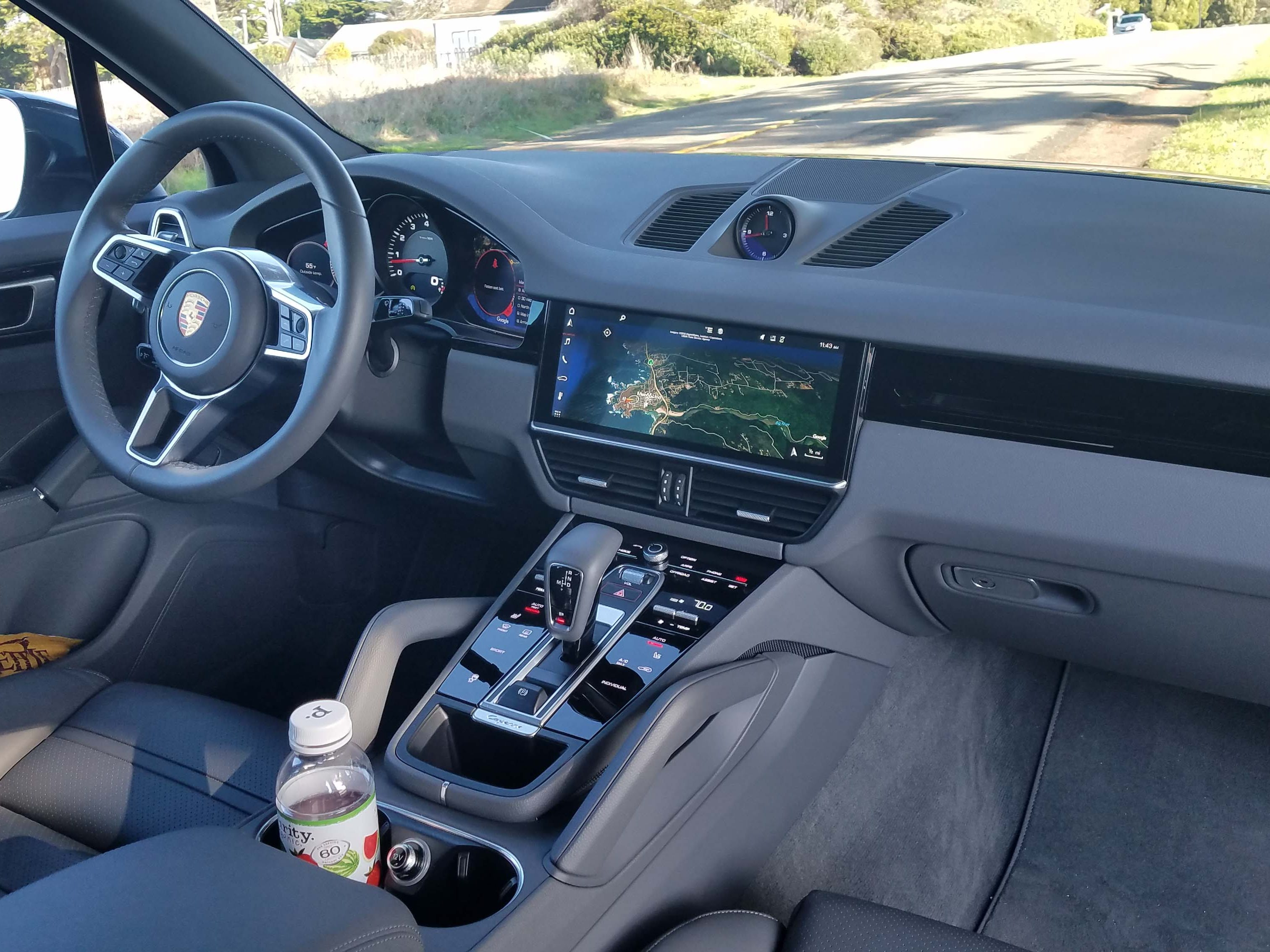 The dash of the 2019 Cayenne looks like the Panamera with its big infotainment screen and sleek black console. The usual, multiple Porsche buttons are still there — but in a more subtle digital graphic layout.
