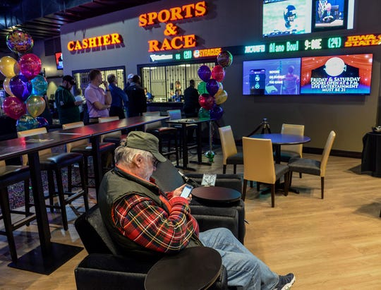 Tom Baldwin of Paint Creek, W.V., tries to download the new online sports betting application onto his smart phone soon after the official ribbon cutting opening of the sportsbook betting app at Mardi Gras Casino & Resort in Crosslanes, W.V. Friday Dec. 28, 2018.
