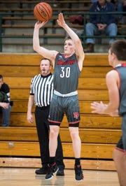 North Posey's Josiah Ricketts (30) shots a three-pointer during the North Posey vs Wood Memorial game of the 2018 Toyota Classic Friday, Dec. 21, 2018.