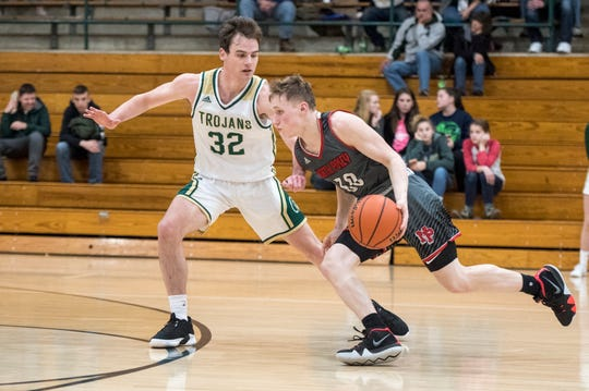 North Posey's Josiah Ricketts (30) drives past Wood Memorial's Paxon Bartley (32) during the North Posey vs Wood Memorial game of the 2018 Toyota Classic Friday, Dec. 21, 2018.