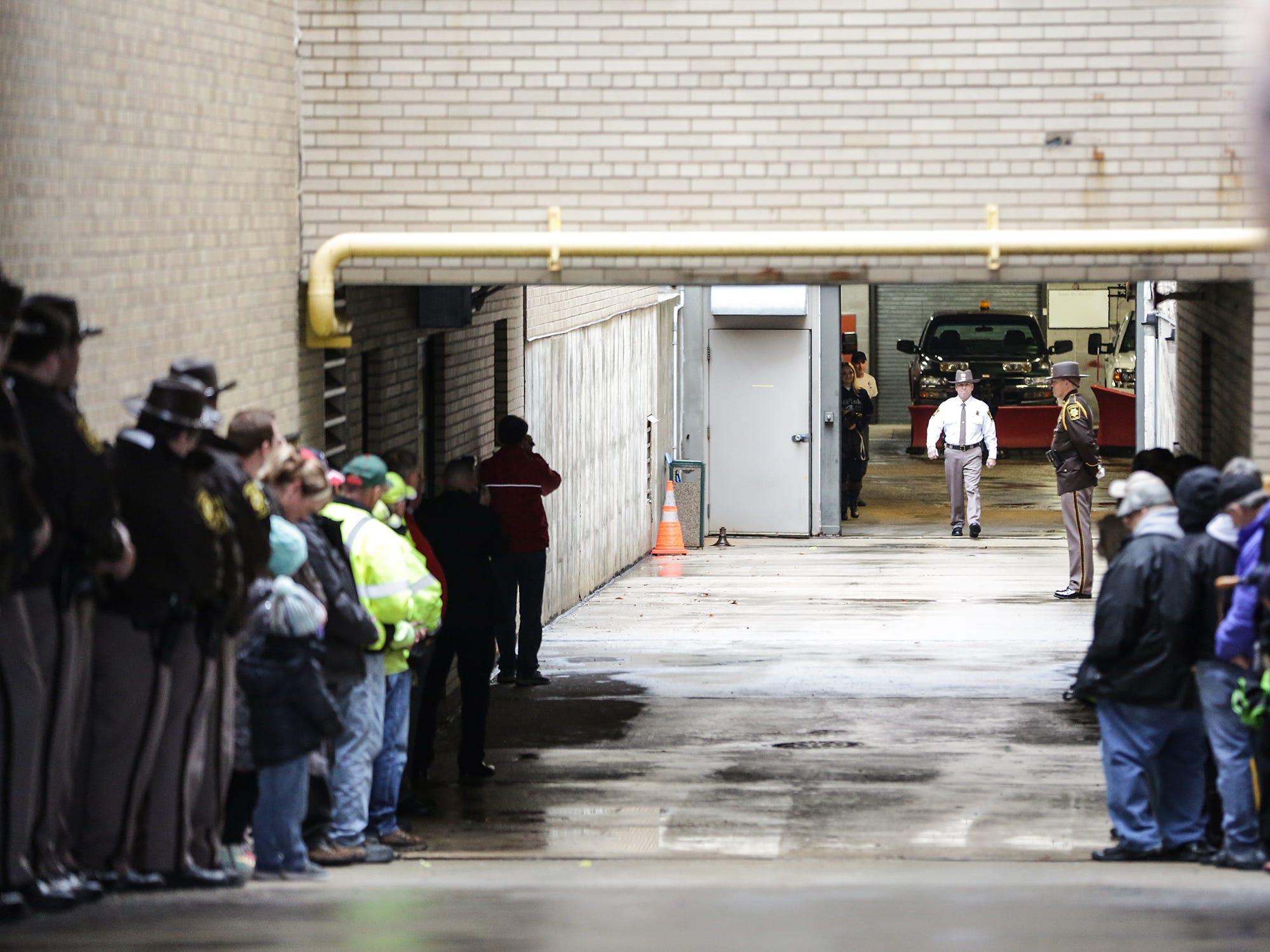 Fond du Lac County Sheriff Mick Fink walks out of the sheriff's office building for the last time as sheriff Monday, January 7, 2019 as he does the ceremonial ramp walk where sheriff's office personel that retire walk up the ramp leading to an underground garage to greet well wishers. Fink retired from the position of Fond du Lac County Sheriff after serving for 12 years. Submitted by Roxanne Abler/USA TODAY NETWORK-Wisconsin