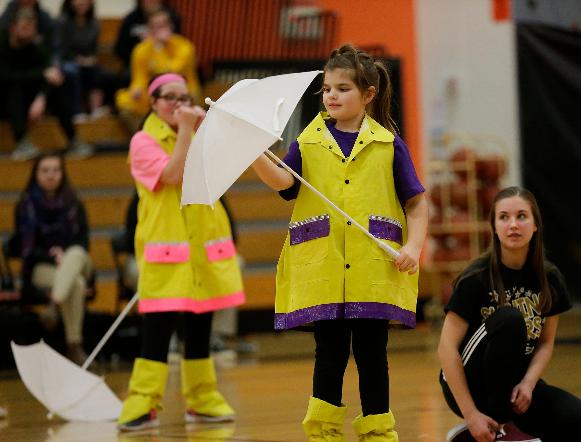 Madison Enright (purple) with the help of Sara Scannell perform with the Shining Stars Dance Team during halftime of the North Fond du Lac High School vs. St. Mary's Springs Academy girls basketball game Jan. 4 at North Fond du Lac High School.