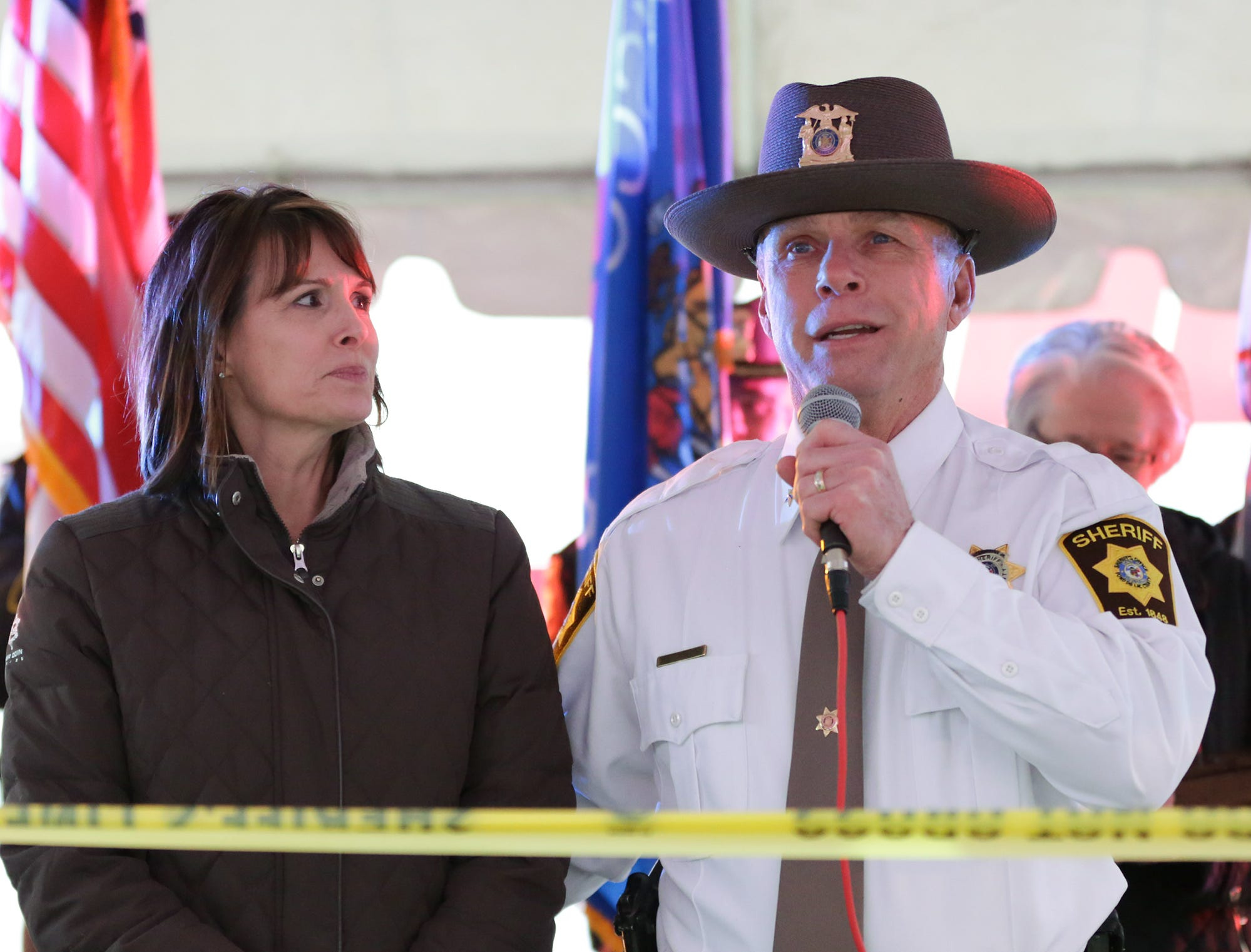 Recently retired Fond du Lac County Sheriff Mick Fink stands next to his wife Mickie Monday, January 7, 2019 as he addresses a crowd that was on-hand to see him do his ramp walk. A tradition the department does to see off retiring personel. Fink retired from the position of Fond du Lac County Sheriff after serving for 12 years. Submitted by Roxanne Abler/USA TODAY NETWORK-Wisconsin