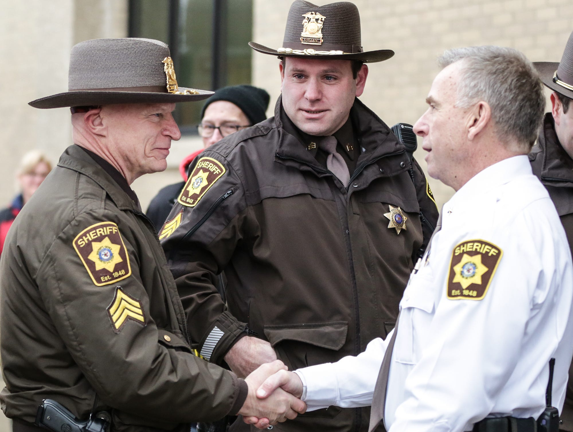 Fond du Lac County Sheriff's Office Sergeant Paul Rottscholl shakes the hand of Fond du Lac County Sheriff Mick Fink as Fink does the ceremonial retirement ramp walk Monday, January, 7, 2019 at the sheriff's office building in Fond du Lac. Fink retired from the position of Fond du Lac County Sheriff after serving for 12 years. Submitted by Roxanne Abler/USA TODAY NETWORK-Wisconsin