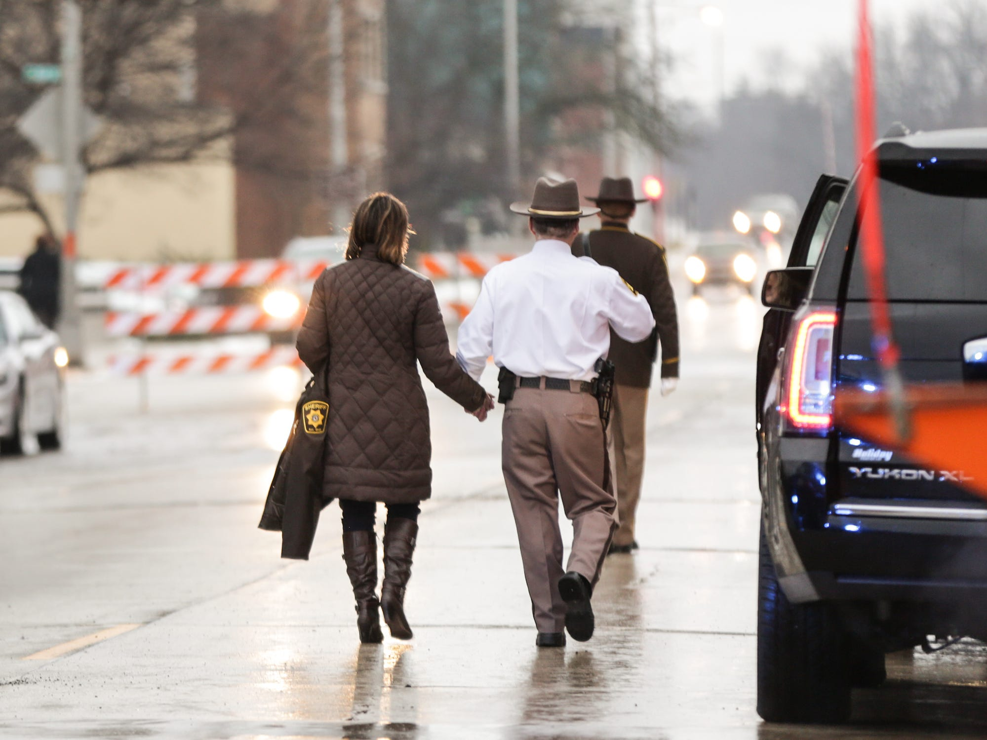 Newly retired Fond du Lac County Sheriff Mick Fink (right) walks with his wife Mickie after taking part in the ramp walk ceremony Monday, January 7, 2019 outside the sheriff's office in Fond du Lac, Wisconsin. Fink retired from the position of Fond du Lac County Sheriff after serving for 12 years. Submitted by Roxanne Abler/USA TODAY NETWORK-Wisconsin