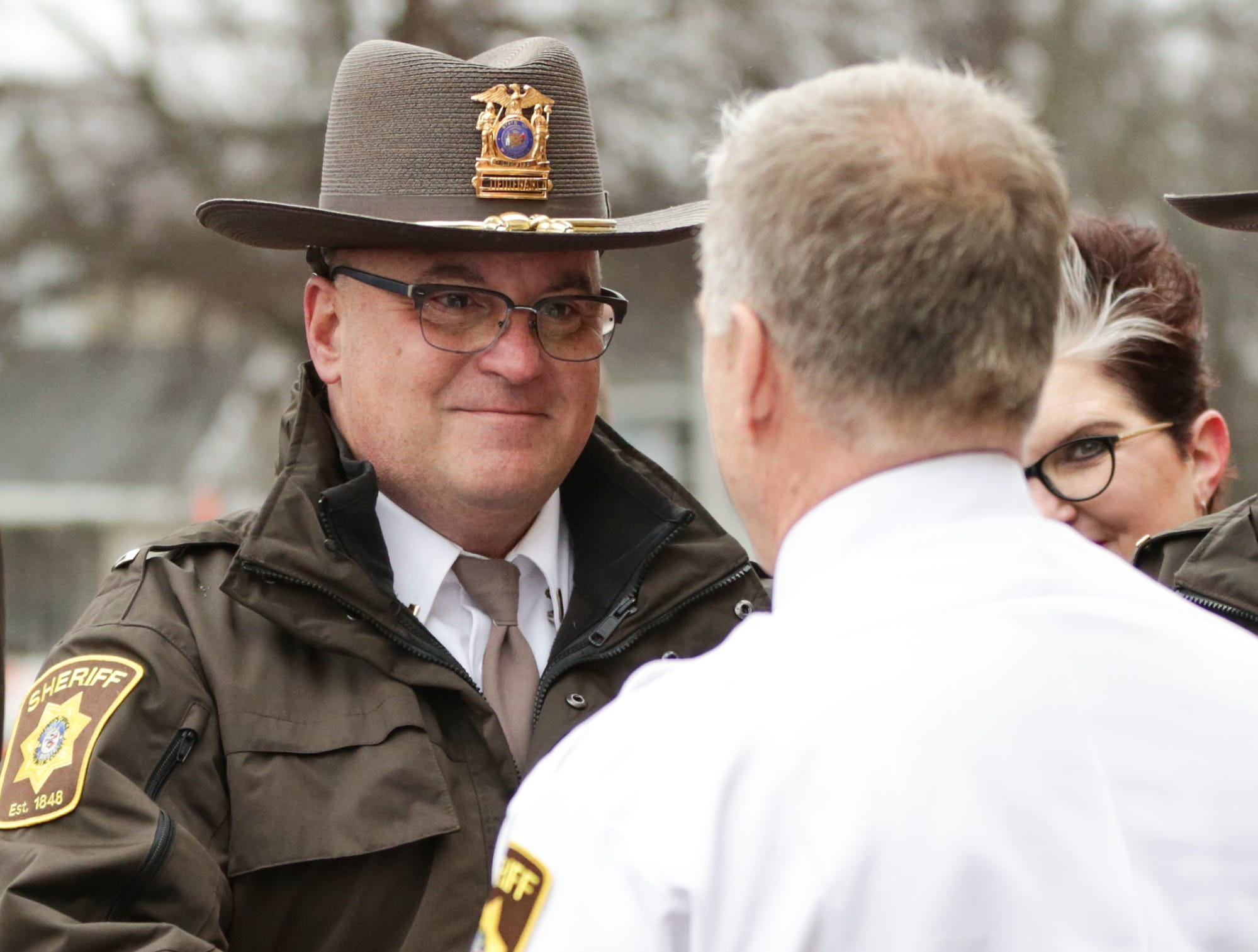 Retiring Fond du Lac County Sheriff Mick Fink shakes hands with Fond du Lac County Sheriff's Office Lieutenant Mike Nolan Monday, January 7, 2019 during Fink's ramp walk which is a department tradition for retiring personel. Fink retired from the position of Fond du Lac County Sheriff after serving for 12 years. Submitted by Roxanne Abler/USA TODAY NETWORK-Wisconsin