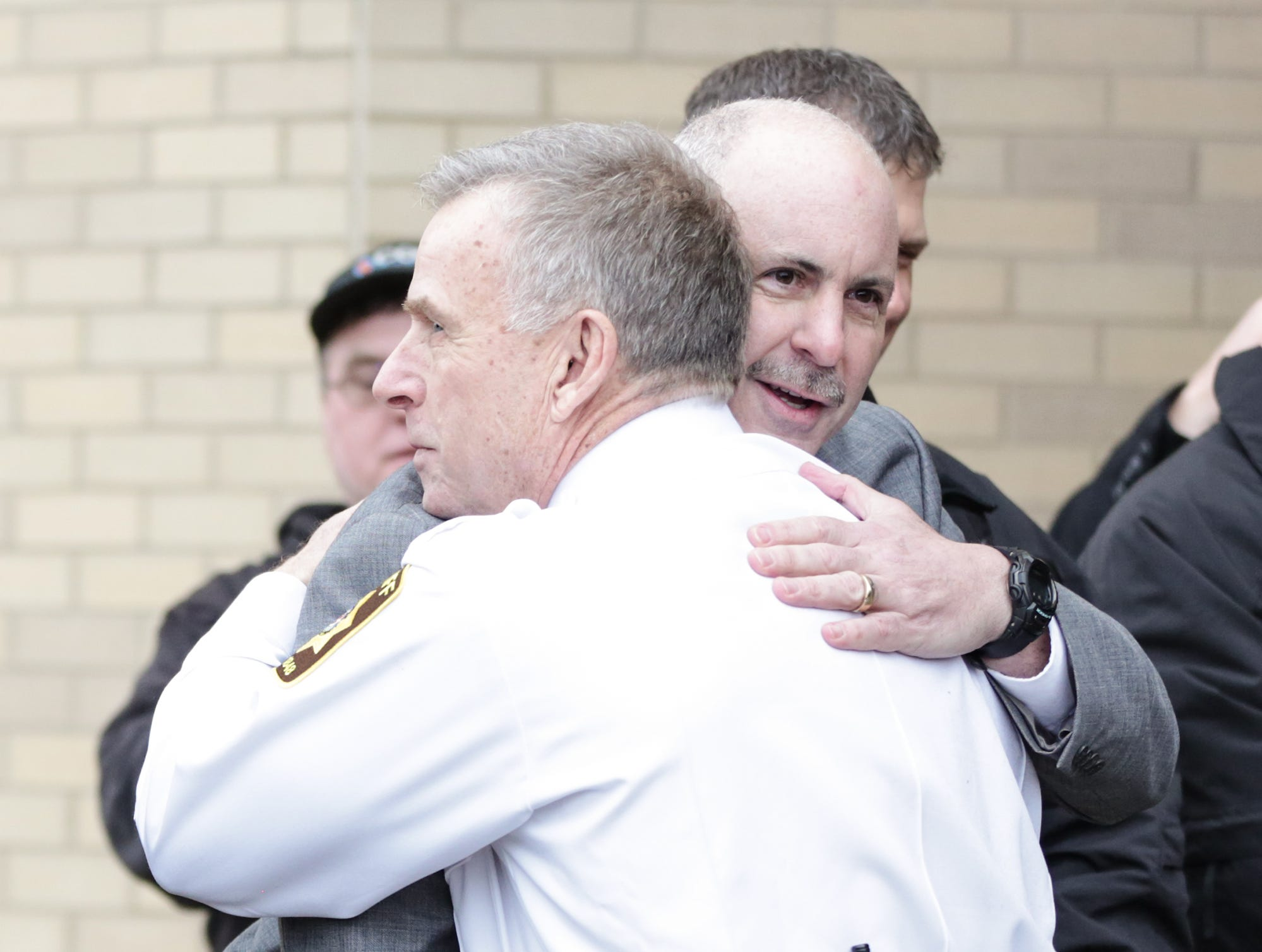 Retiring Fond du Lac County Sheriff Mick Fink hugs Fond du Lac County Sheriff's Office Detective Nate LaMotte Monday, January 7, 2019 during Fink's ramp walk which is a department tradition for retiring personel. Fink retired from the position of Fond du Lac County Sheriff after serving for 12 years. Submitted by Roxanne Abler/USA TODAY NETWORK-Wisconsin