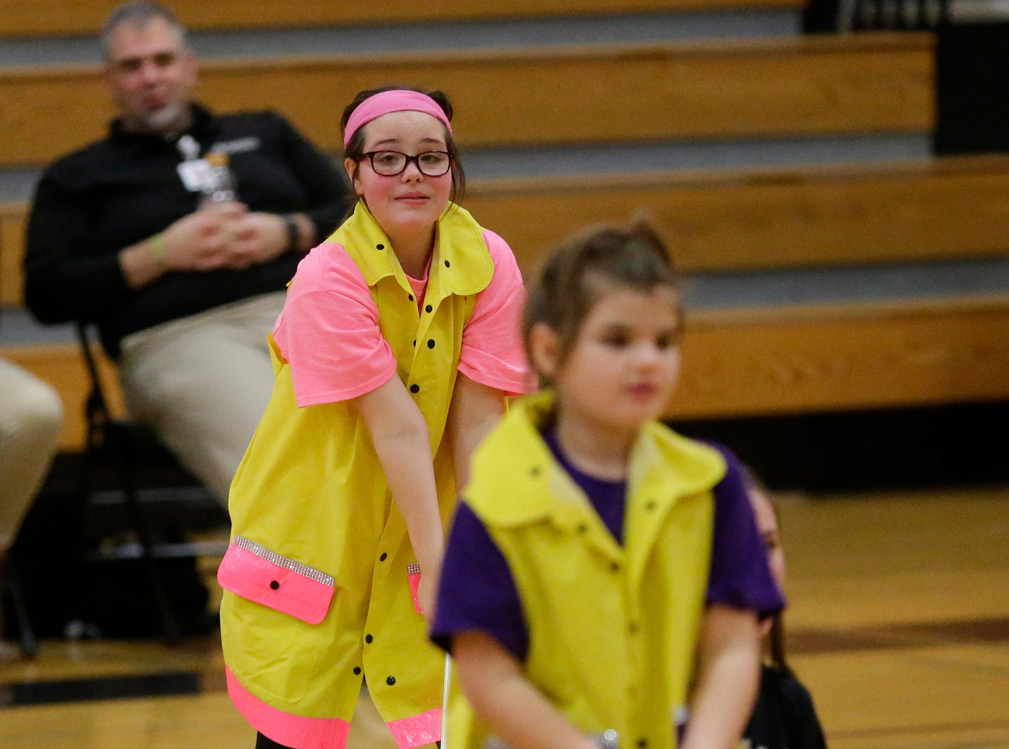Olivia Gelllings (pink) performs with the Shining Stars Dance Team during halftime of the North Fond du Lac High School vs. St. Mary's Springs Academy girls basketball game Jan. 4 at North Fond du Lac High School.