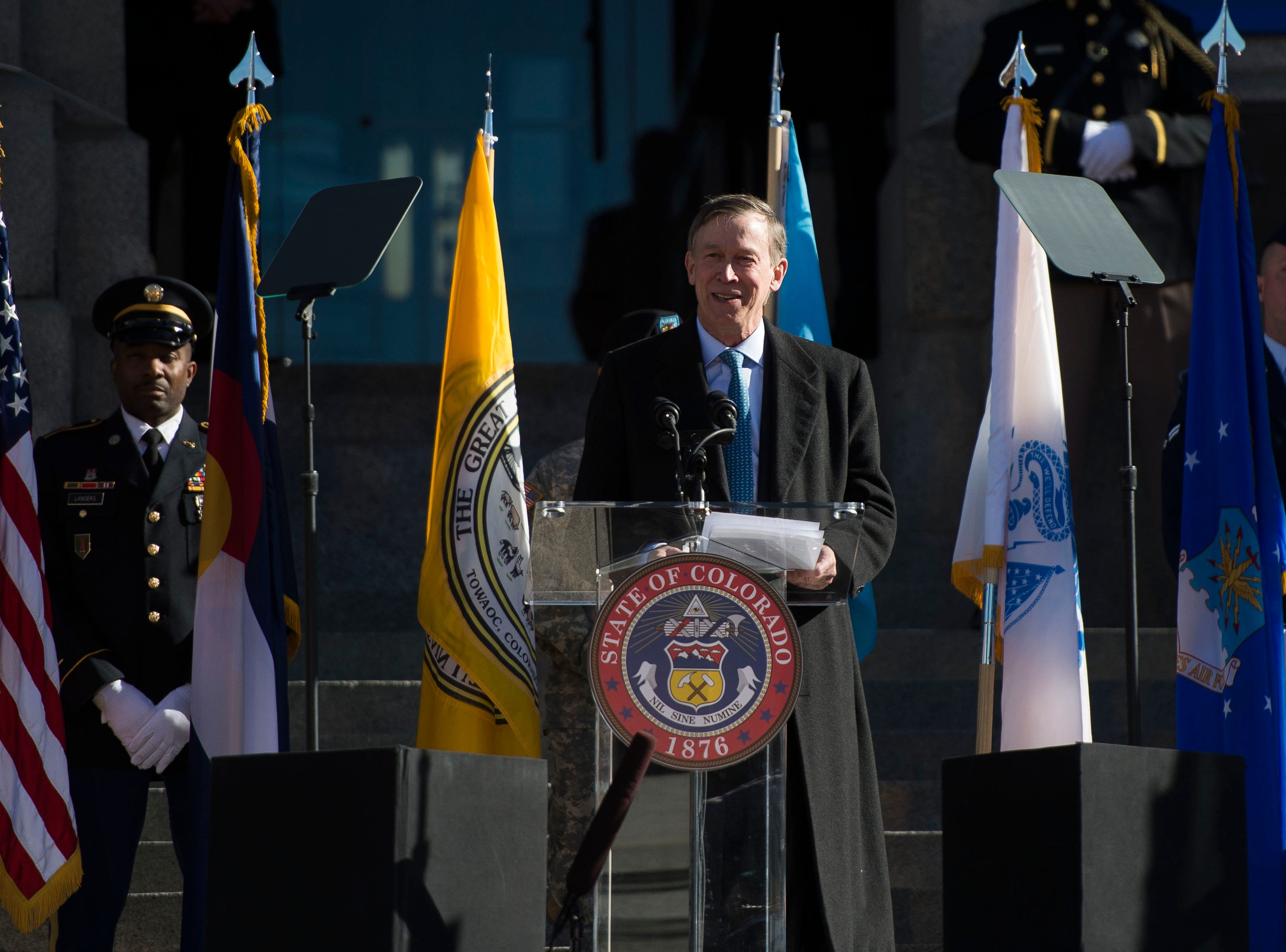Outgoing Colorado State Governor John Hickenlooper gives a speech during the inauguration of Colorado State Governor Jared Polis on Tuesday, Jan. 8, 2019, in front of the Colorado State Capital building in Denver, Colo.