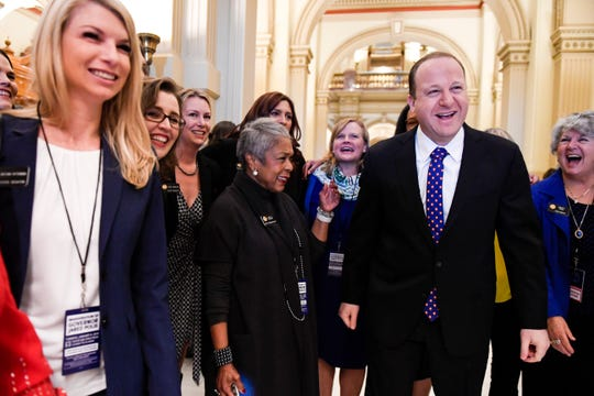 DENVER, CO - JANUARY 8: Colorado Governor elect Jared Polis jokes with members of the state house and senate before his inauguration at the Colorado State Capitol on Tuesday, January 8, 2019. (Photo by AAron Ontiveroz/The Denver Post/Pool)