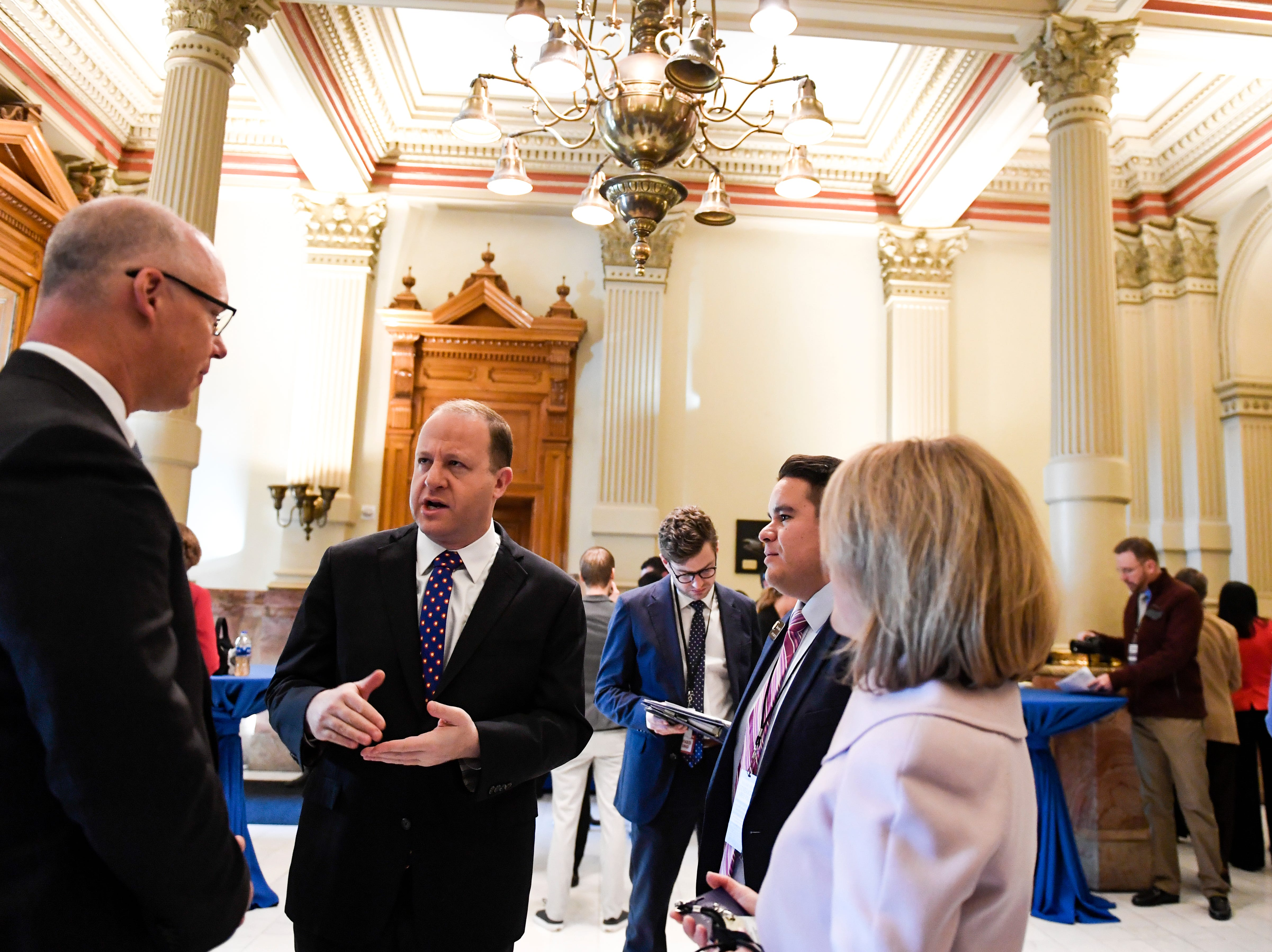 DENVER, CO - JANUARY 8: Colorado Governor elect Jared Polis speaks to (from left to right) state Senators Kevin Priola and Dominick Moreno and Rep. Shannon Bird before his inauguration at the Colorado State Capitol on Tuesday, January 8, 2019. (Photo by AAron Ontiveroz/The Denver Post/Pool)